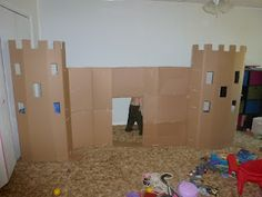 Daddy's Cardboard Castle    See how Daddy transformed a bunch of empty cardboard boxes into this awesome castle!  http://mommyandfourpeasinapod.blogspot.com/2012/07/daddys-cardboard-castle.html