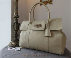 Mulberry Classic Bayswater in Snowball Grainy Patent Leather > https://www.npnbags.co.uk/naughtipidginsnestshop/prod_6260437-Mulberry-Classic-Bayswater-in-Snowball-Grainy-Patent-Leather-As-New.html