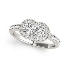 Let your love shine with this charming two-stone diamond ring. Created in 14K white gold, this ring showcases a duo of shimmering two 1/2 ct. diamonds, representing both your friendship and loving commitment, nestled side-by-side, set in precious 14K white gold setting and arranged in perfect alignment across the center of the ring. Smaller round accent diamonds are channel-set into the ring's shank and around the two center stone, completing the design. Radiant with 1 1/3 ct. t.w. of…
