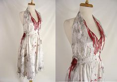 white, Marilyn Monroe style, satin halter dress....transformed with grungy paint distresses, tattered hem, bloody bite mark and neckline. perfect for your Marilyn Zombie, Bloody Homecoming Queen or Living Dead Girl Costume. CONDITION: this was cleaned before it was turned into a