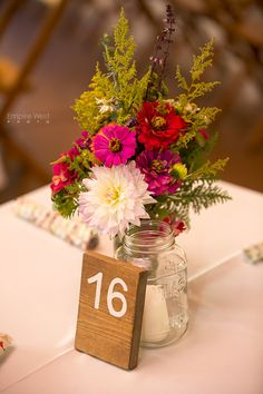 Country wedding centerpiece and table number...mason jars and wood numbers.
