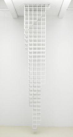 "Sol LeWitt Untitled, 1987. Wood painted white, 12' 3-3/4"" x 2' 5"" x 2' 5"" (375.3cm x 73.7cm x 73.7cm)."
