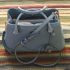 """Coach Pale Blue Handbag. Coach Handbag with handles and shoulder straps. Center zipper pocket, dog leash closure, inside pockets and zipper pockets. The prettiest pale blue which is Pantone color for the year and a beauty to carry for Easter. 12""""w x 9""""h x 6""""d strap is removable and also adjustable. Coach Bags Shoulder Bags"""