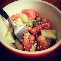 Summer salad: Tomatoes, cucumbers, feta, chickpeas & basil. Minus the cheakpeas... Maybe black beans?