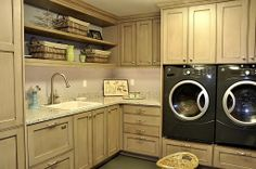 Front-loading washer and dryer, laundry sink and plenty of cabinet storage