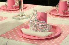 Princess party place setting with crown and wand.