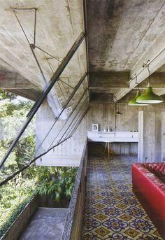 concrete + open metal framed windows + old tile floor