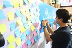 Infiniti Mall visitors writing their wishes & greetings for their fathers on our SBI Life Wishing Wall.