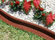 Red EcoBorder EarthCurb landscape edging is multi-purpose and can be used anywhere from against the lawn, adjacent to a walkway or patio, or to trim around a fixture like a fence or AC pad.