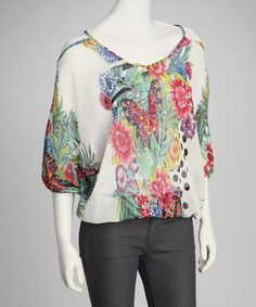 Take a look at this White & Blue Cutout Top by Madison Paige