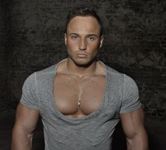 Model Maurice Gernet by TeeJott Models. They always manage to get their models in some kind of chest-baring outfit. in this case, a deep scoop neck shirt. Low Cut Tank Tops, Male Fitness Models, Male Eyes, Fitness Studio, Mens Fitness, Neck T Shirt, Scoop Neck, Muscle, How To Wear