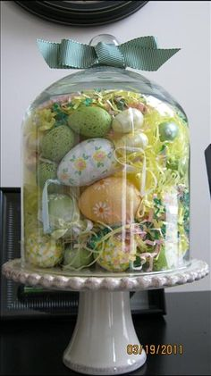 For Adelyn's dresser spring decor: cloche stuffed with Easter eggs large and small, yellow Easter grass tied up with a grossgrain green ribbon set atop the Villa Petite Pedestal! Hoppy Easter, Easter Bunny, Easter Eggs, Easter Gift, Easter Table, Easter Decor, Easter Centerpiece, Centerpieces, Easter Dinner
