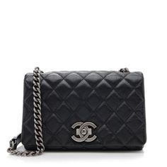 From the Pre-Fall 2015 Collection, this Chanel Small City Rock Flap bag is made from quilted black goatskin with antique silver-tone hardware. Details include a chain and leather shoulder strap, a back pocket, and push-lock closure. The interior is fully lined with one zippered pocket.