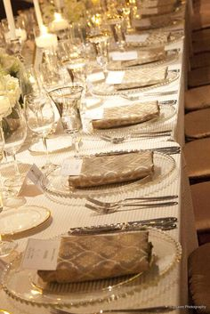 The gold patterned napkins are the perfect addition to the ivory textured linen and glass charger. This California Wine Country wedding was nothing but elegant!