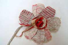 Thread and Thrift: Fabric Flowers  Great idea for old quilts & other treasured fabric items that are falling apart