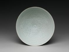 Bowl with Two Boys and Foliage  Period:Southern Song dynasty (1127–1279) Date:12th–13th century Culture:China Medium:Porcelain with incised and combed decoration under celadon glaze (Qingbai ware) Dimensions:H. 2 7/8 in. (7.3 cm); Diam. 8 1/4 in. (21 cm); Diam. of foot: 2 1/4 in. (5.7 cm)