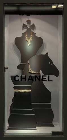 Black and White Paper/Foamcore Windows 2014 - Visual Merchandising/ Chanel Display accounts/ simple concept which has been well executed/ low lighting