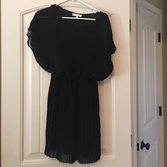 Black Lush dress Black short sleeve dress. Cute With heels or flats! Love the skirt portion with the accordion detail Lush Dresses Mini