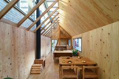 Japanese studio Hibinosekkei has added a small wooden playhouse to a kindergarten in the city of Saga to encourage independent domestic role play