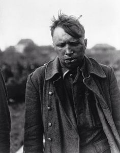 A member of a Waffen-SS squadron beaten up by members of the regular German Wehrmacht after being accused of murdering American prisoners of war at Malmedy, 1944