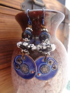 These earrings can go easily with jeans and a white shirt, or a spring dress! They feature wonderful Enameled Copper components in dark denim blue with white accents, tiny black daisies, and raised copper dots. They are stacked with black Lampwork glass discs with white ruffles and sparkly faceted Blue Goldstones. Suspended from Navy Niobium earwires (hypo allergenic) for the extra pop of blue! One of a Kind! Length: Just under 2 1/2, including earwires.  Original List Date March 26, 2016