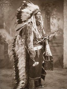Native American Chief holding the peace pipe