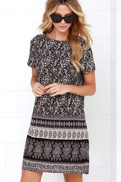 With a day as beautiful as today, the best dress to don is clear ... the Agree to Filigree Black Print Shift Dress! Lightweight woven rayon is effortlessly breezy across a bateau neckline that meets cute short sleeves. A black and white botanical print swirls throughout the relaxed shift bodice, finished with bands of complementary print. Unlined. 100% Rayon. Dry Clean Only. Imported.