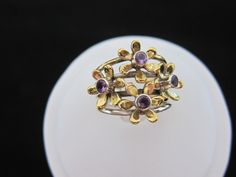 A personal favorite from my Etsy shop https://www.etsy.com/listing/245179604/two-tone-amethyst-sterling-silver-ring