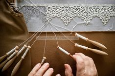 'Merletto a tombolo' Pillow lace or Bobbin Lace, is created using linen thread with 'fuselli' wooden bobbins, woven with pins on intricate designs. Anghiari lace is all woven from linen thread as apposed to cotton thread in most other regions of Italy. Filet Crochet, Irish Crochet, Crochet Lace, Crochet Pillow, Crochet Edgings, Crochet Motif, Crochet Shawl, Antique Lace, Vintage Lace