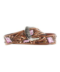 Rustic charm meets urban chic with this eclectic accessory. Combining handcrafted leather with pink florals and a hand-etched removable buckle, this piece ensures pants stay stylishly secure. 1.5'' wideLeather / metalImported