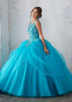 Princess Perfect, This Tulle Quinceañera Ballgown with Beaded Skirt Features an Intricately Beaded Bodice and Illusion Neckline. Keyhole Corset Back. Matching Stole i