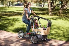 This is awesome! Taga Child Carrier Bike and Luxury Baby Stroller In One