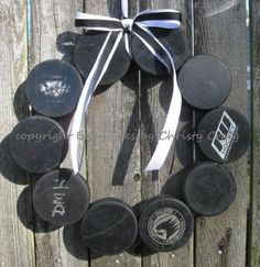 Make a wreath out of pucks to spread hockey cheer (and show of your scoring skills). Rink Hockey, Hockey Party, Hockey Games, Hockey Mom, Hockey Stuff, Hockey Tournaments, Hockey Crafts, Hockey Decor, Montreal Canadiens