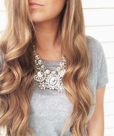Love the hair and casual/chic combination of the statement necklace and t-shirt