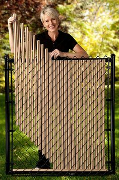 Beige Ridged Slats for Chain Link Fence Beige Ridged Slats for Chain Link Fence - Weaving strips from an old bamboo fence thru a chain link fence instead of using plastic strips. PVC Privacy Slats for Chain Link Fences - Lock-Top Style Backyard Fences, Garden Fencing, Backyard Landscaping, Garden Art, China Garden, Garden Floor, Garden Beds, Garden Projects, Garden Tools