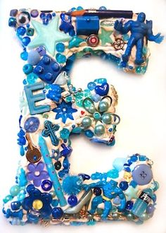 """Great collage idea for kids. Ask each child to bring in """"everything blue"""" collage items to collage the first letter of their own name. (assign different colors to each child) Tdeb:)"""