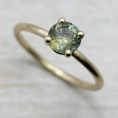 Our eco-friendly Basket Solitaire Engagement Ring in recycled 14k yellow gold, customized with an ethical & fair trade Montana sapphire.