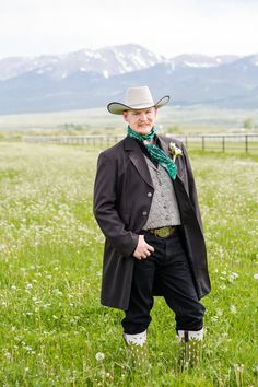 Rustic, Western grooms in Ariat shirt and full duster jacket, wild rag and cowboy hat on wedding day at Painted View Ranch in Westcliffe, Colorado.  Wedding Venue with horses and gorgeous mountain views.  Tray loves Courtney Photos by Katie Corinne Photography #westcliffe #westcliffewedding #coloradowedding #coloradoweddingphotographer #mountainwedding #mountainweddingphotographer #rockymountainbride
