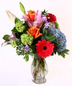 Bunches of Blooms - This cheerful vase includes a beautiful variety of roses, lilies, hydrangea, and more. #KittelbergerFlorist #RochesterFlowers
