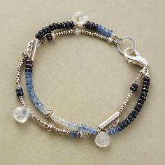 MOONLIGHT BLUES BRACELET A handmade moonstone and sapphire bracelet, in which moonstones shine out from a spectrum of blue sapphires mixed with sterling silver.