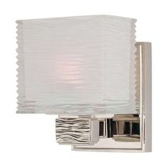 Bright and reflective wall sconce featuring a Modern rectangular frosted shade with a fantastic wavy texture. Great for a bathroom vanity.