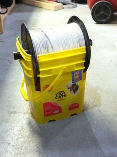 Reuse old cat litter container for use as wire spool!
