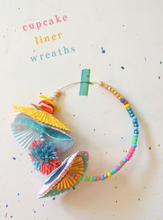 Liner Wreaths Kids make wreaths and crowns from cupcake liners, beads, and wire.Kids make wreaths and crowns from cupcake liners, beads, and wire. Recycling For Kids, Diy For Kids, Crafts For Kids, Preschool Crafts, Fun Crafts, Creative Activities For Kids, Cupcake Liners, Cupcake Wrappers, Arts And Crafts Movement