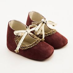 Dark purple baby shoes from leather