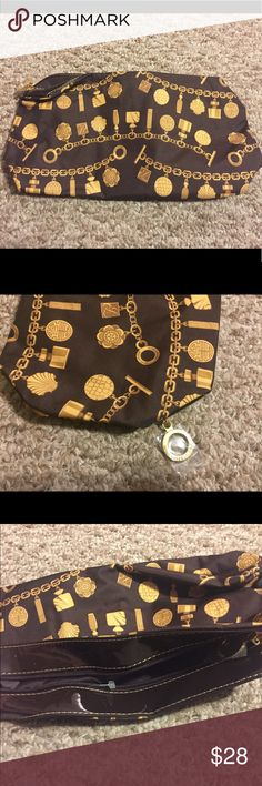Estée Lauder makeup bag w/charm braclet design Estée Lauder travel makeup bag with brown/gold braclet design brown patent leather trim. Zipper closure with Estée Lauder pull. Estee Lauder Bags Mini Bags