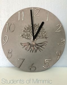 This magnificent clock was pewtered by Sim from our Wednesday class. Keeping the numbers and tree matt compliment the concrete clock perfectly. www.mimmic.co.za Pewter Art, Pewter Metal, Copper Metal, Metal Clay, Aluminum Foil Crafts, Metal Crafts, Metal Tape Art, Metal Embossing, Foil Art