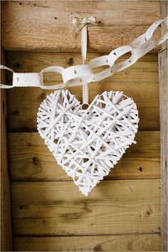 paper hearts hanging from trees and draping around dance floor. Cheaper than lights? Big heart dangling behind heater & Alex's table.