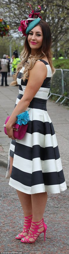 Aintree racegoers dress to the nines for Ladies Day #dailymail