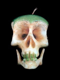 Unique food sculptures created by talented Russian artist Dimitri Tsykalov.        Three-dimensional human skulls were carved into fruits and vegetables.