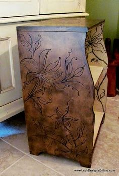 This blogger shows how she uses a Dremel tool to carve designs into wood projects she is redoing, restaining, repainting.